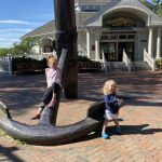 Kids sitting on a large anchor