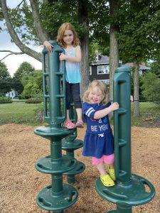 girls climbing at playground