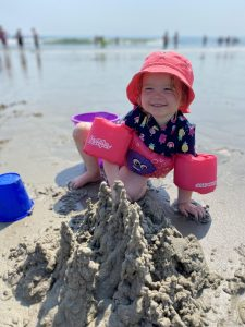 girl making a drip sand castle