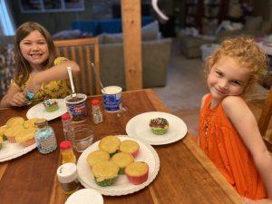 girls decorating cupcakes