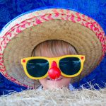 girl in a sombrero and large sun glasses