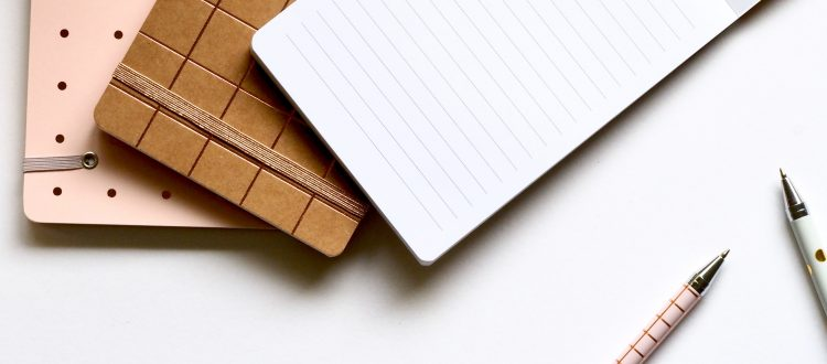 notebooks and pens