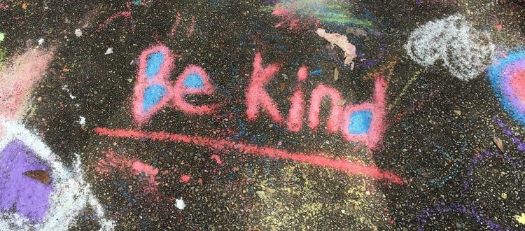 be kind written in pink chalk on pavement