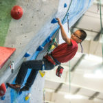 boy climbing on wall
