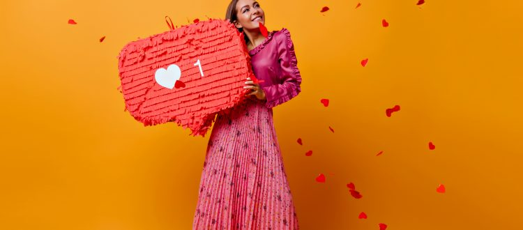 Woman with one heart pinata and hearts floating around her