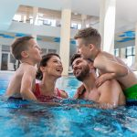 family of four in a hotel pool